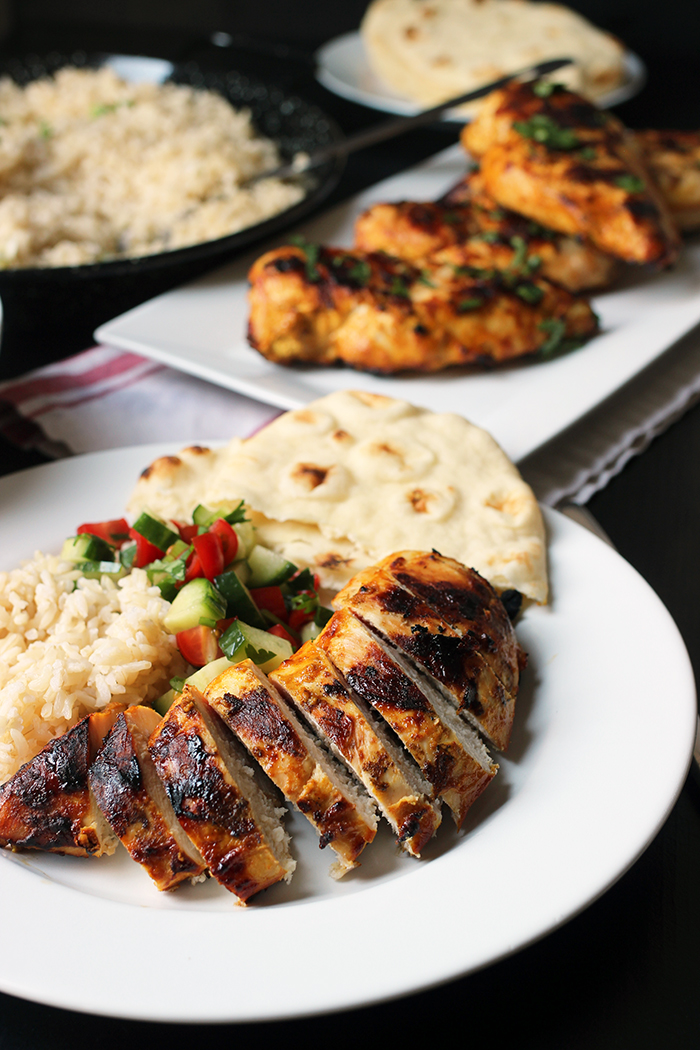 plate of chicken slices with salad rice and naan