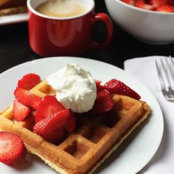 breakfast table with waffles and berries