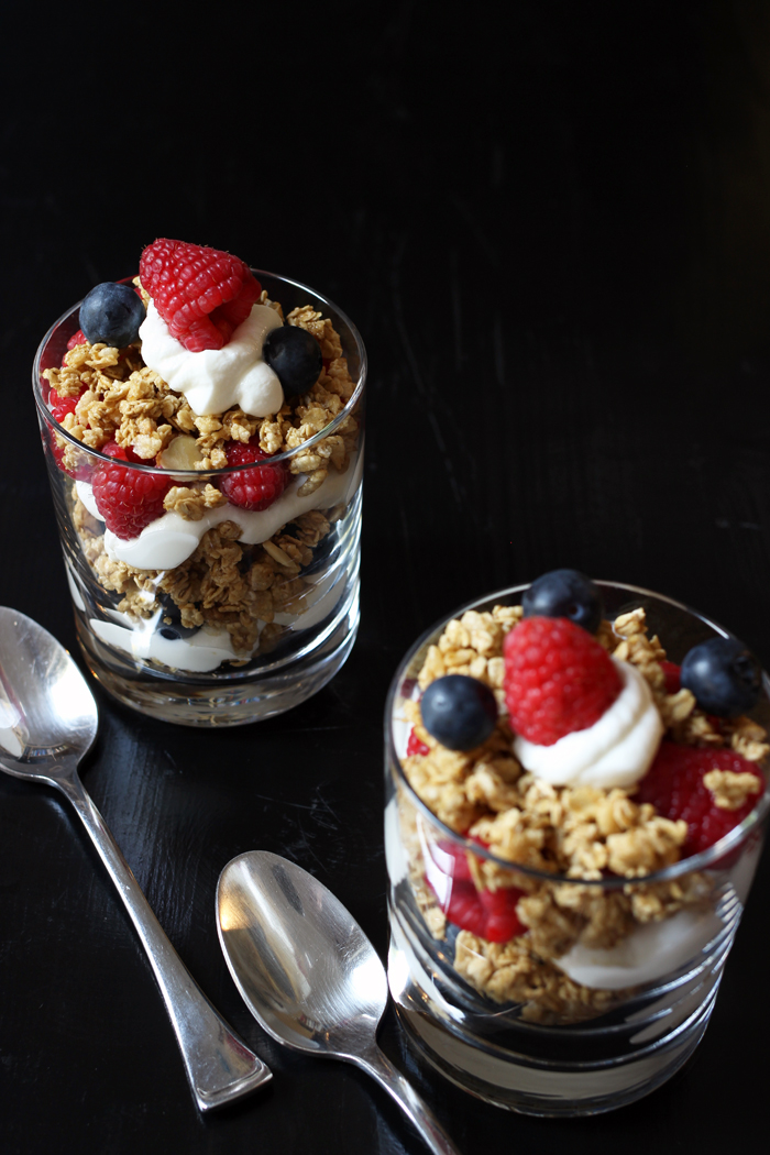 yogurt granola parfait with raspberries and blueberries