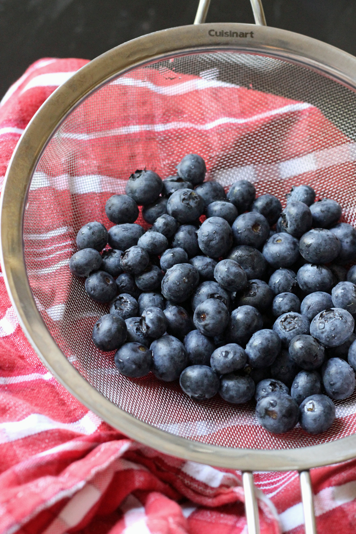 strainer full of berries