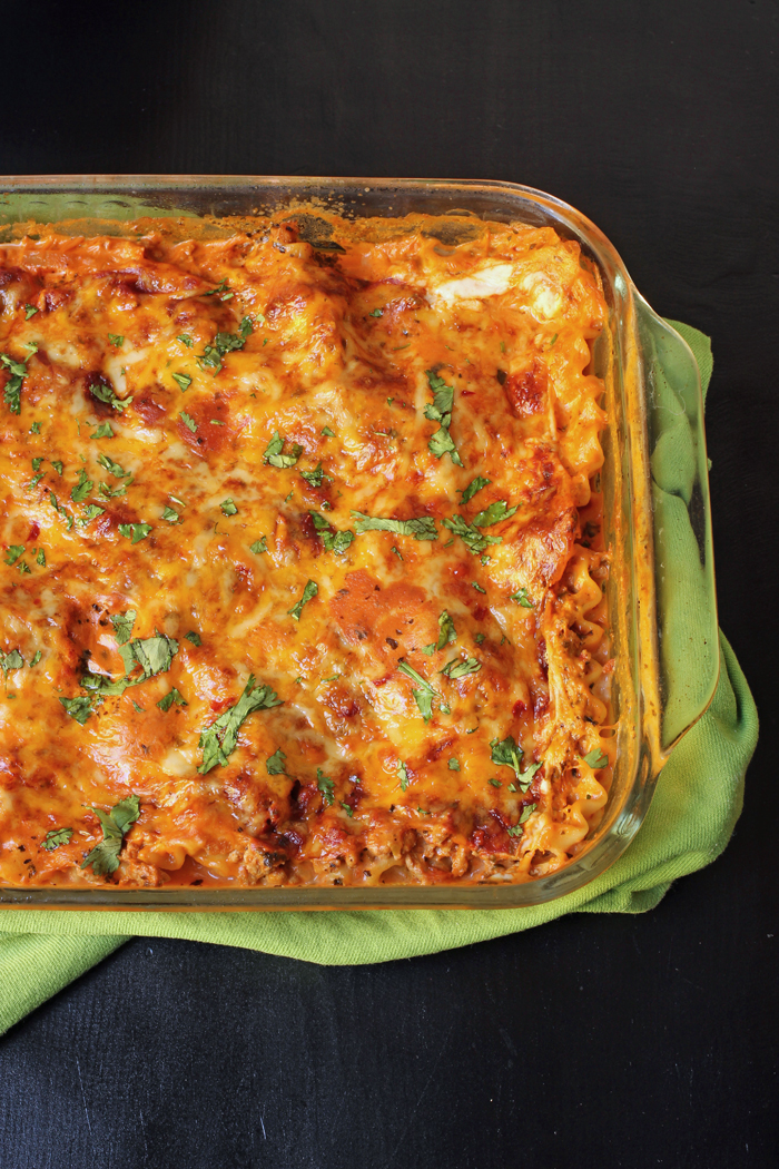 casserole of mexican lasagna on green cloth