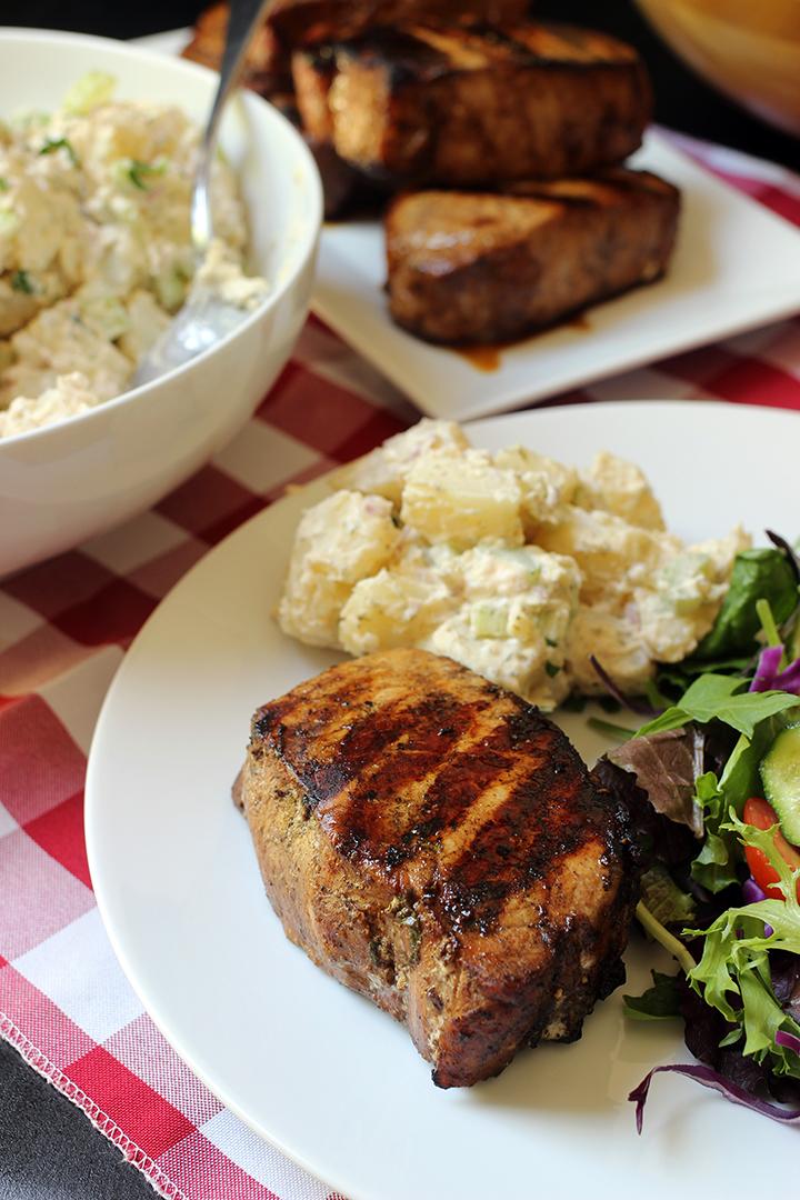 grilled balsamic pork chop on dinner plate