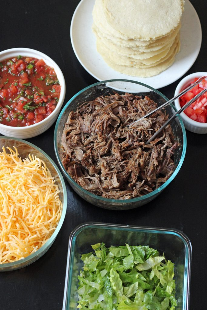 taco shells, slow cooker taco fillings, and toppings