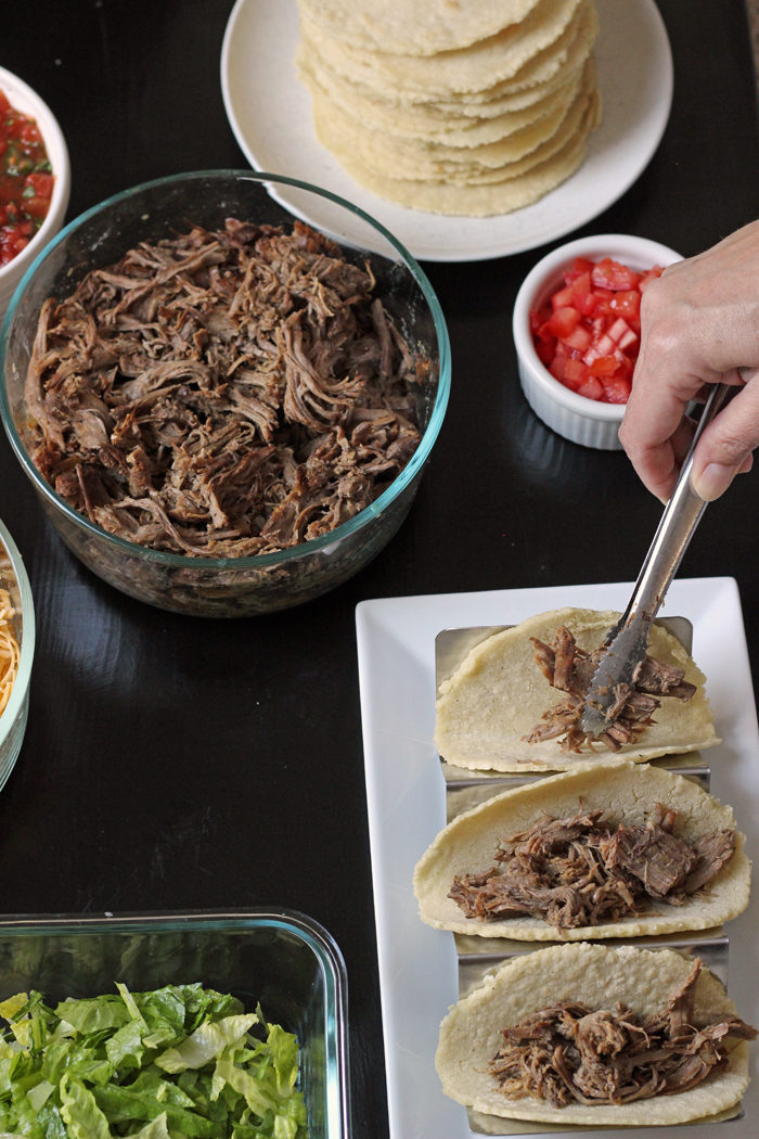 Shredded Beef Tacos being assembled