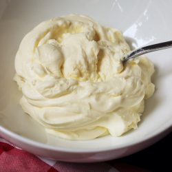 whipped cream in a bowl with a spoon