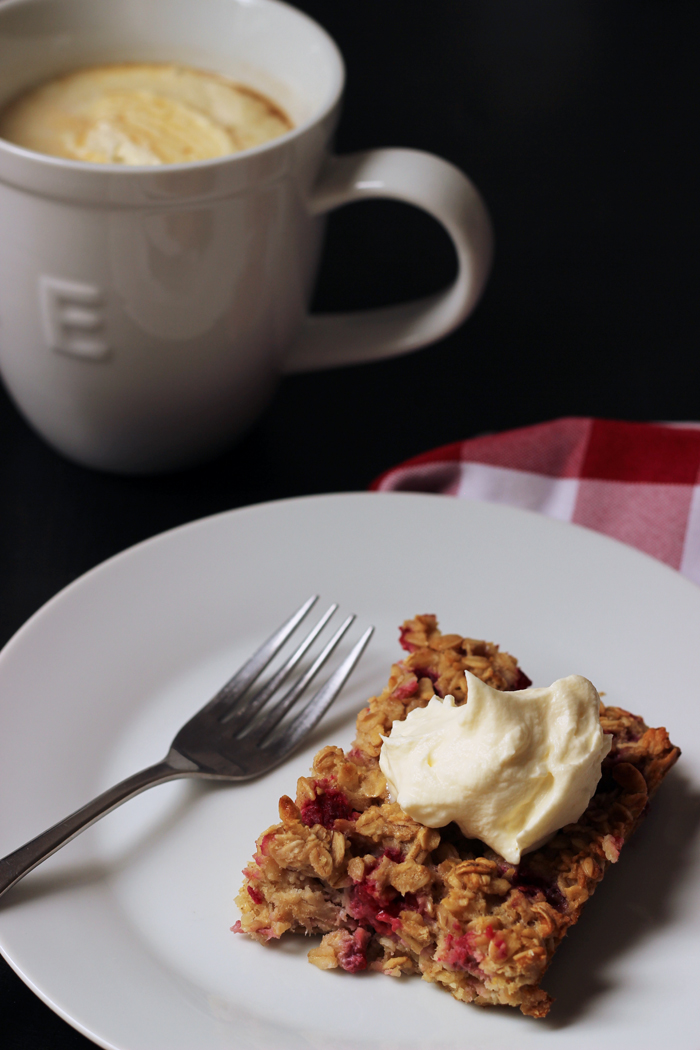slice of cake with homemade whipped cream on top