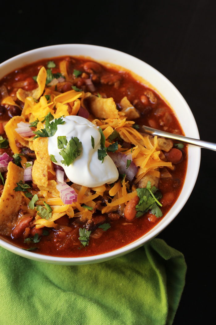 bowl of chili with green napkin