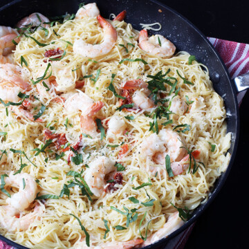 Shrimp pasta in pan on table