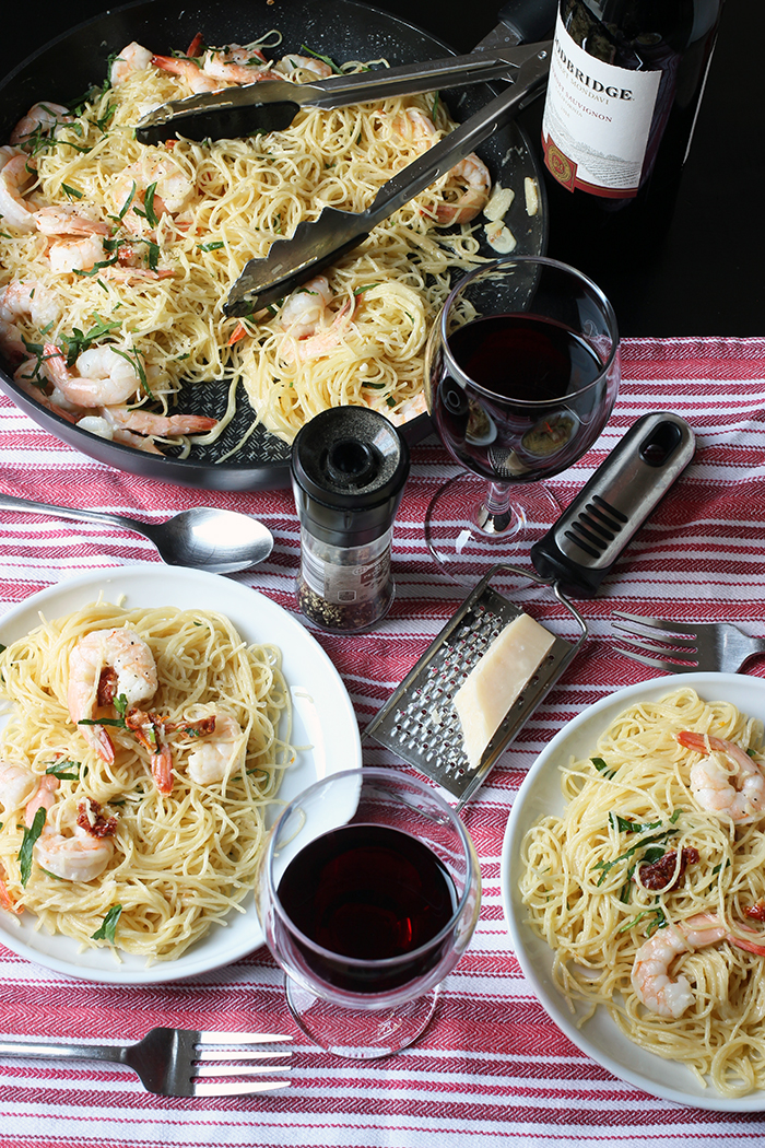 table set with shrimp pasta
