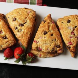 A tray of chocolate strawberry scones, with berries
