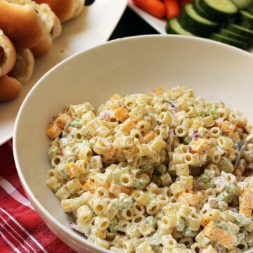 bowl of macaroni salad on table with other dishes