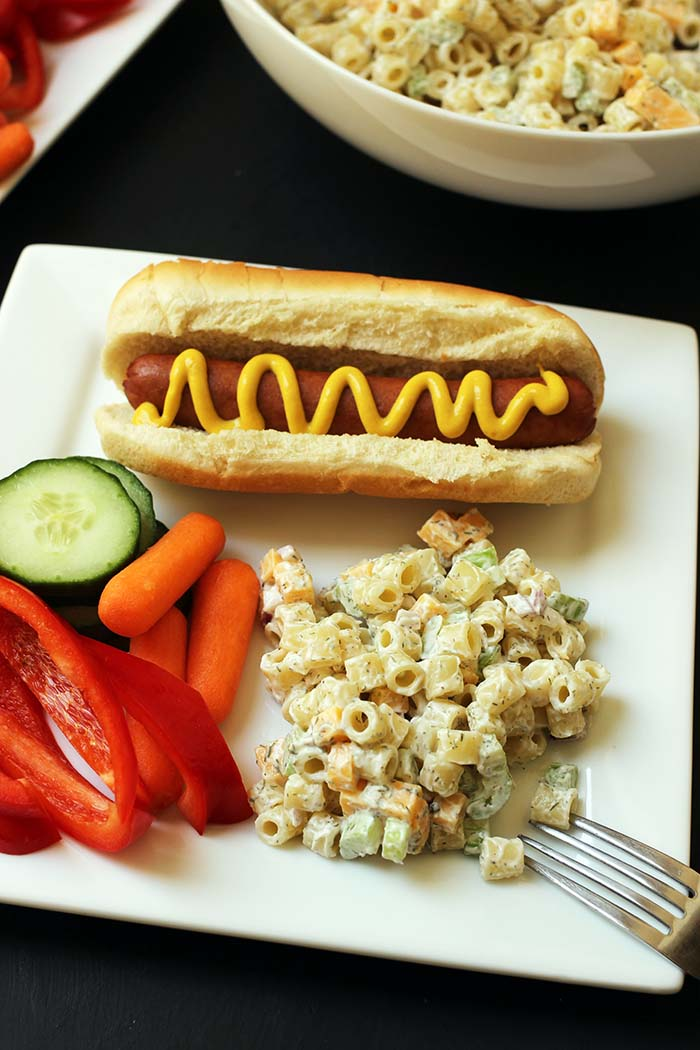 plate of mac salad and hot dog and veg