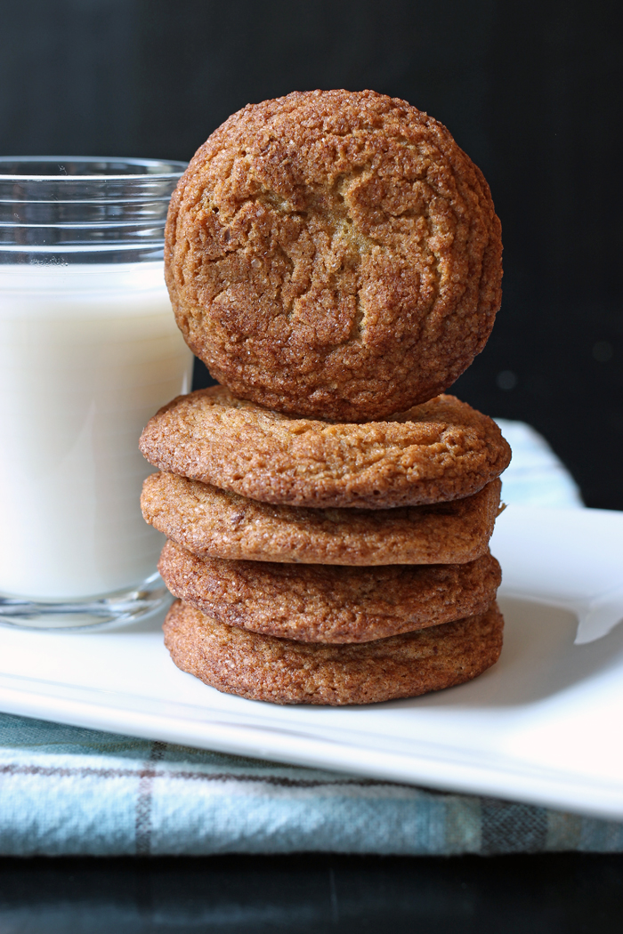 stack of healthy snickerdoodles and a glass of milk