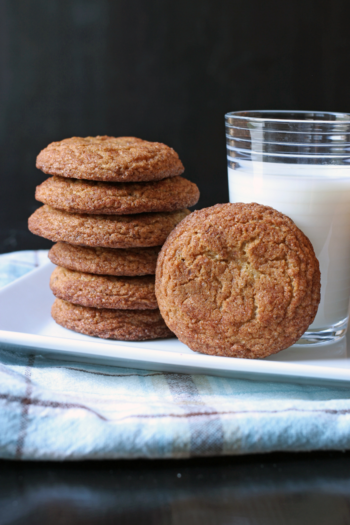 stack of healthy snickerdoodles and a cup of milk