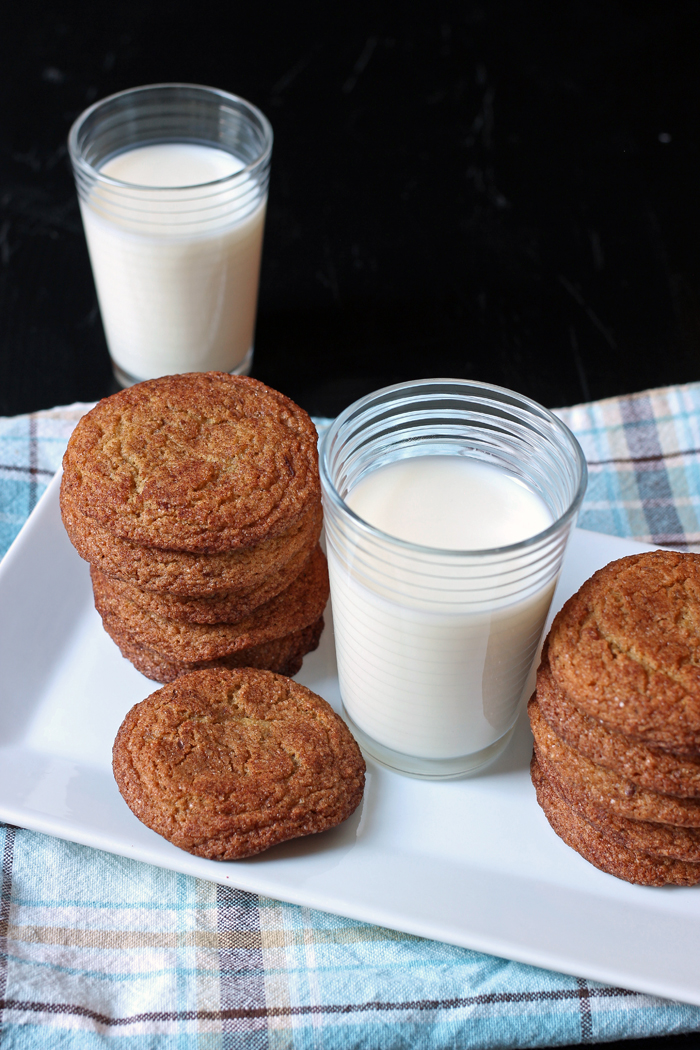 Healthy Snickerdoodles on a plate with two glasses of milk