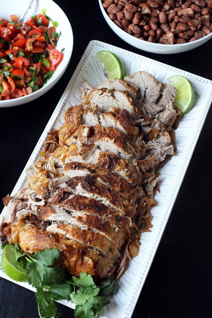 cumin pork loin roast sliced on plate