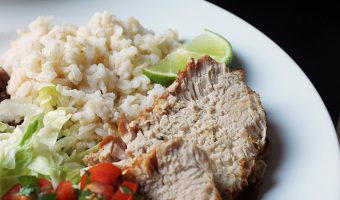 slices of cumin pork loin on dinner plate
