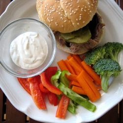 burger and veggie dippers on a plate