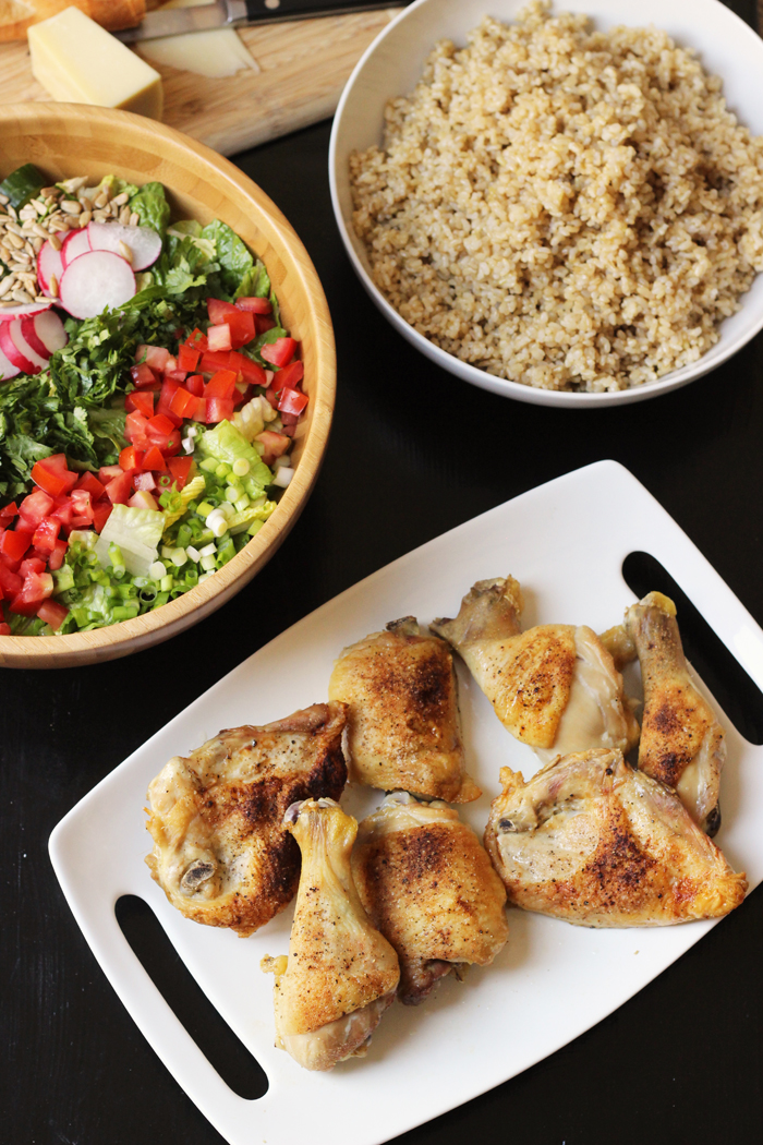 platter of baked chicken, salad, and bowl of rice