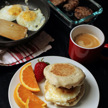 breakfast sandwich with table spread