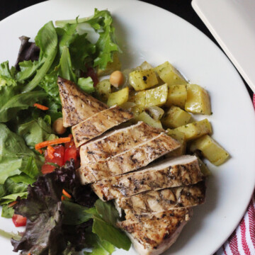 sliced chicken on plate with vegetables