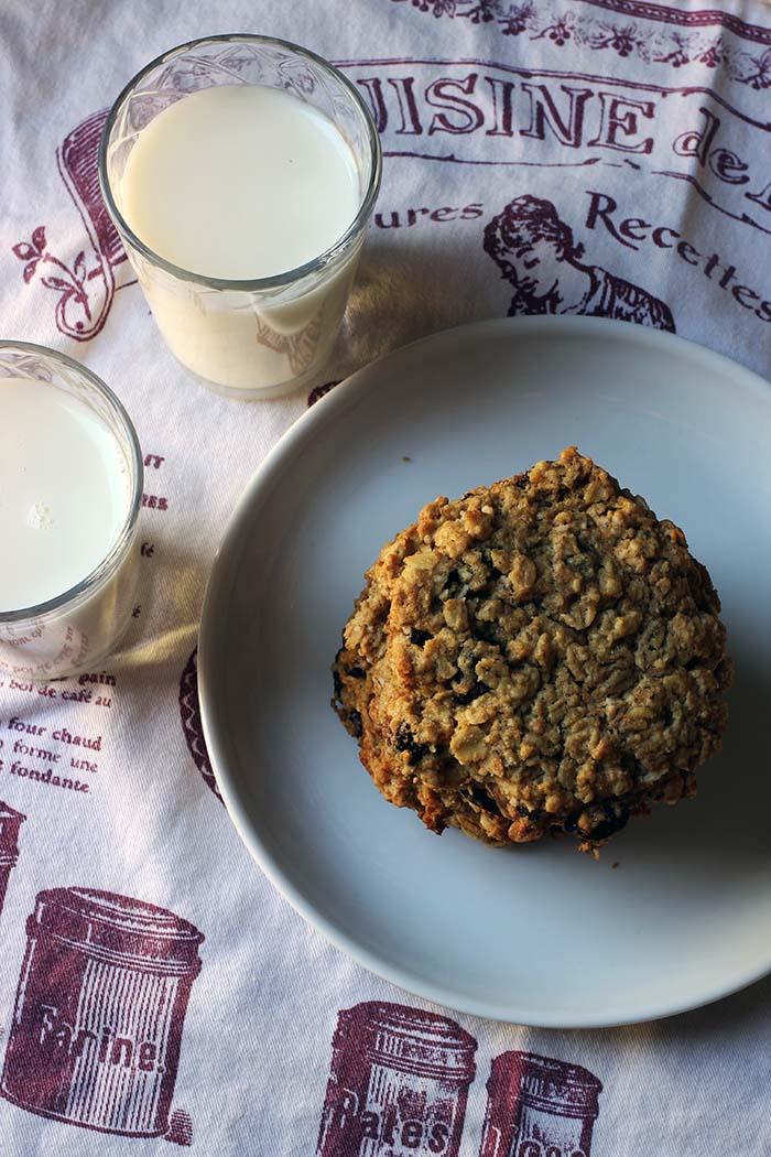 plate of cookies cups of milk on tea towel