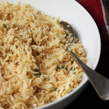 spoon resting in a bowl of rice