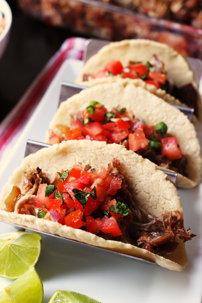 taco rack with three carnitas tacos