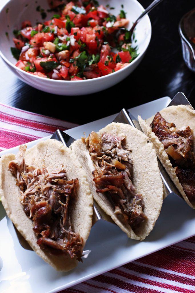 taco holder with three carnitas tacos
