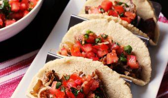A trio of tacos on taco holder