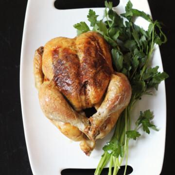 A roast chicken on a platter