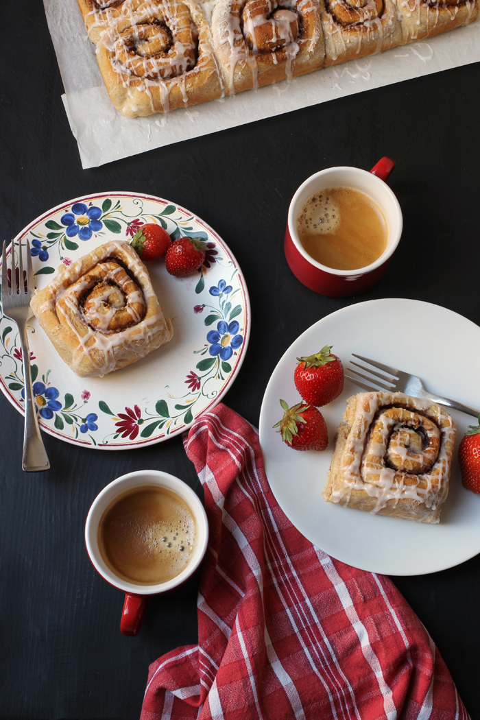 table set with coffee and cinnamon rolls