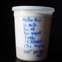 muffins in plastic tub with blue writing