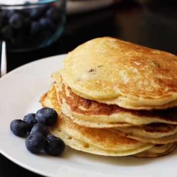 A close up of stack of Pancakes on a plate