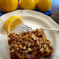 slice of coffeecake on plate with lemon slice