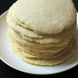 A stack of tortillas on a plate