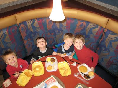 boys sitting on a table on a restaurant