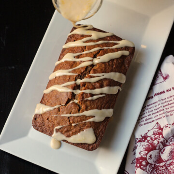 A applesauce bread drizzled with glaze