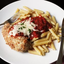 A plate of penne and chicken