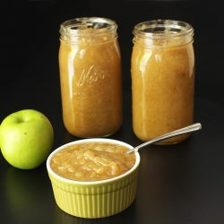 Apple and jars and bowl of Sauce