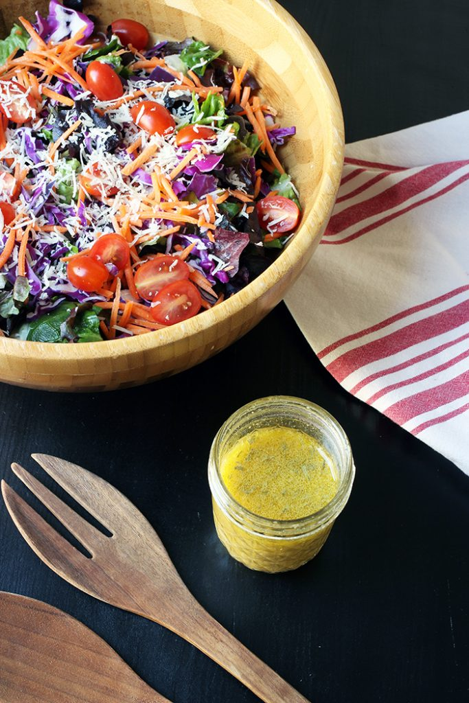 overhead look at salad with vinaigrette jar