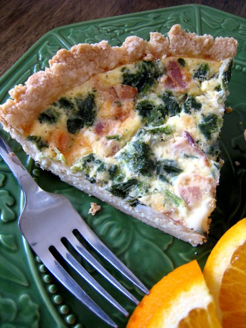 slice of Bacon and Spinach Quiche on a plate