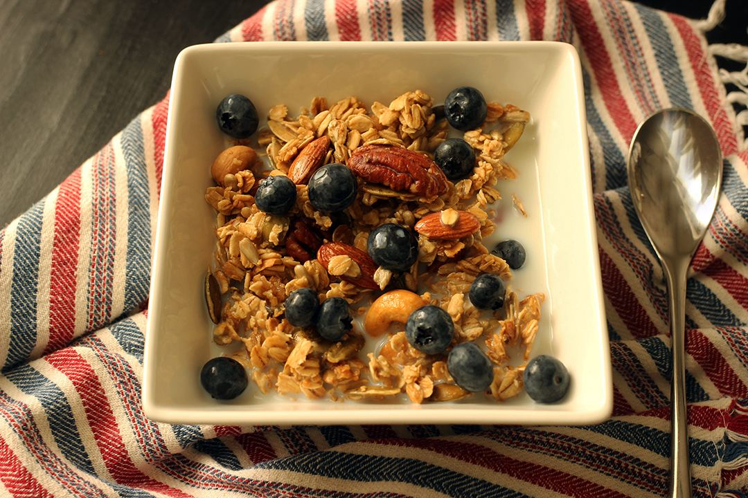 maple granola in bowl with blueberries