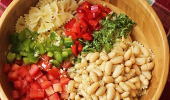 A bowl of beans and pasta salad ingredients
