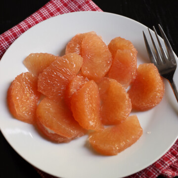 A plate of grapefruit supremes