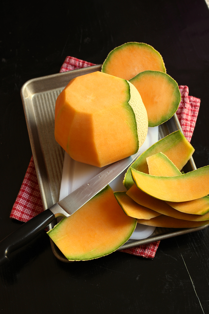 cantaloupe rind being cut off