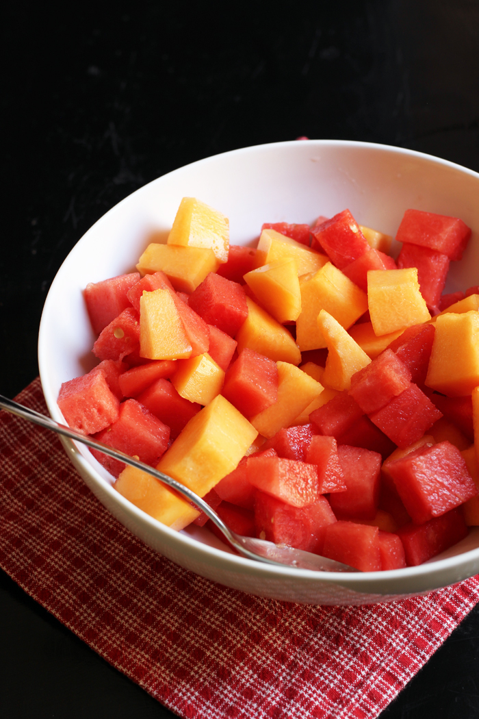 a bowl of cut melon