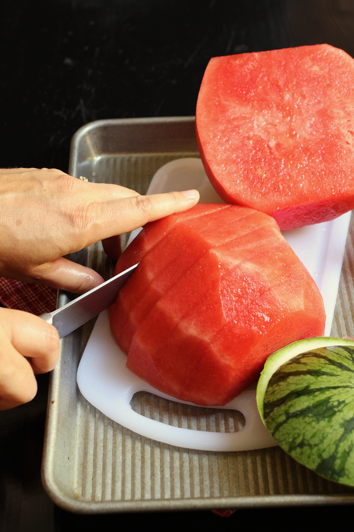 Watermelon being sliced