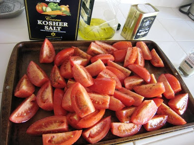 tomatoes on a baking sheet and other ingredients