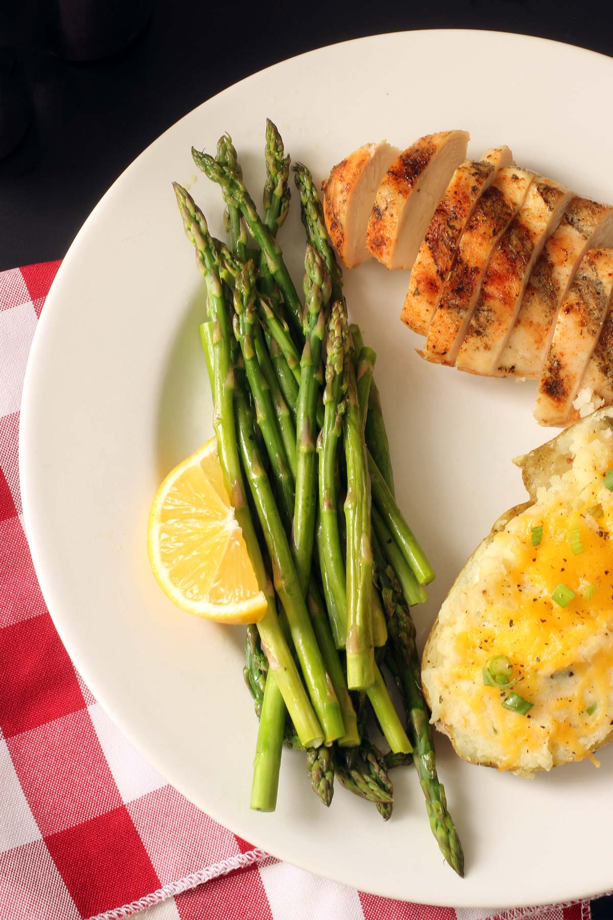 asparagus and lemon on dinner plate